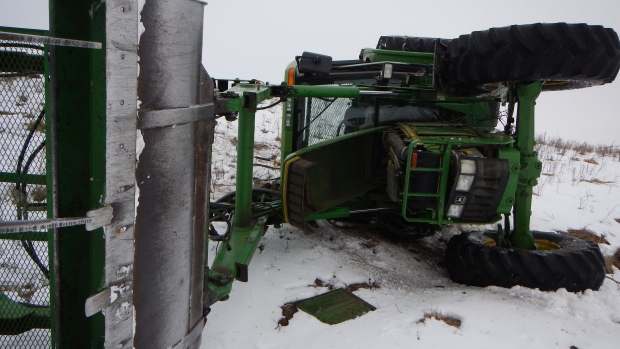 Tractor theif in Alberta chased by RCMP on a snowmobile.